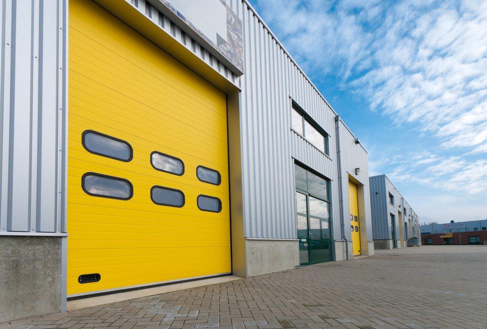 Industrial warehouse with yellow roller shutter doors